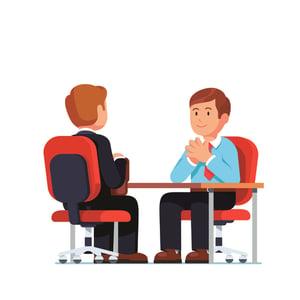 Boss coaching an employee